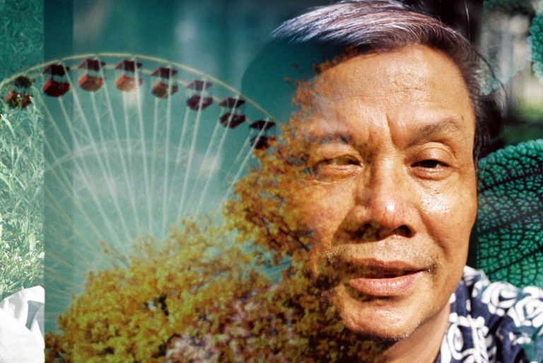 My father's portrait is overlaid by a pattern of ferris wheel from water park in Hanoi, Viet Nam on August, 2013.